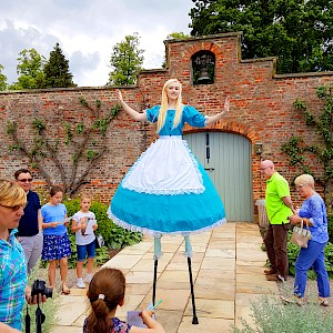 uk alice in wonderland stilt walkers