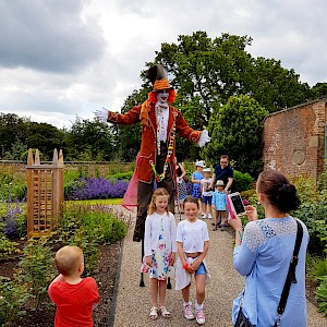 alice in wonderland stilt walker hire
