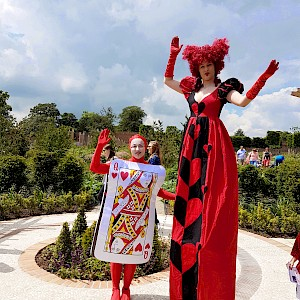 alice in wonderland stilt walker