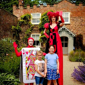 alice in wonderland stilt walker uk